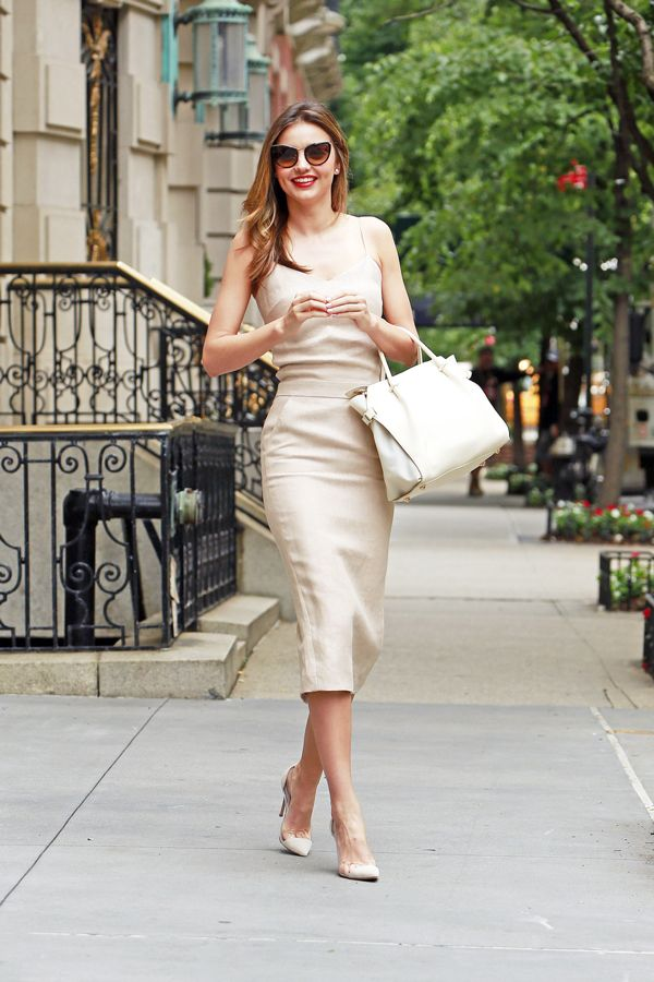 a60acf40559 Miranda Kerr in a beige Maxmara dress paired with Miu Miu sunglasses and  Nina Ricci bag. image